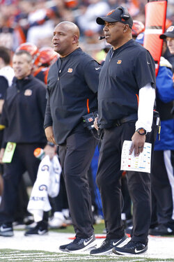 FILE - In this Dec. 2, 2018, file photo, Cincinnati Bengals head coach Marvin Lewis, right, works the sidelines with special assistant Hue Jackson in the second half of an NFL football game against the Denver Broncos, in Cincinnati. Marvin Lewis and Hue Jackson are back on the sideline as head coaches this week for the NFLPA Collegiate Bowl. (AP Photo/Frank Victores, File)