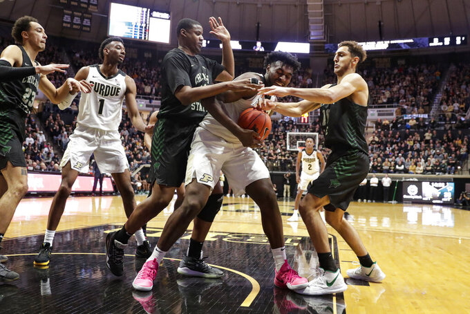 Purdue forward Trevion Williams (50) fights for position between Chicago State center Solomon Hunt (35) and forward Amir Gholizadeh (10) during the second half of an NCAA college basketball game in West Lafayette, Ind., Saturday, Nov. 16, 2019. Purdue defeated Chicago State 93-49. (AP Photo/Michael Conroy)