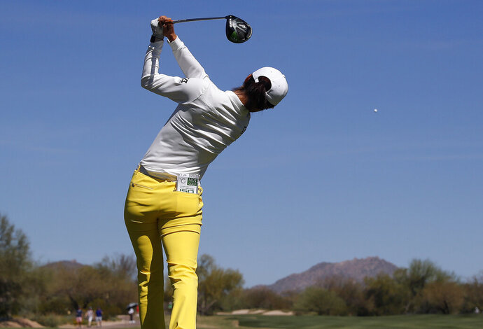 Yu Liu hits from the second tee during the third round of the Founders Cup LPGA golf tournament, Saturday, March 23, 2019, in Phoenix. (AP Photo/Matt York)