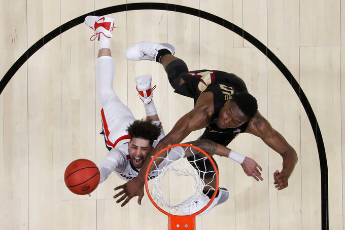 Gonzaga guard Josh Perkins, left, drives to the basket past Florida State forward Mfiondu Kabengele during the first half an NCAA men's college basketball tournament West Region semifinal Thursday, March 28, 2019, in Anaheim, Calif. (AP Photo/Marcio Jose Sanchez)