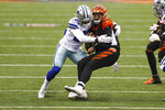 Dallas Cowboys defensive back Deante Burton (33) sacks Cincinnati Bengals quarterback Brandon Allen (8) in the second half of an NFL football game in Cincinnati, Sunday, Dec. 13, 2020. (AP Photo/Aaron Doster)