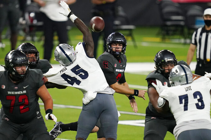 UNLV quarterback Max Gilliam (6) throws a pass against Nevada during the first half of an NCAA college football game Saturday, Oct. 31, 2020, in Las Vegas. (AP Photo/John Locher)