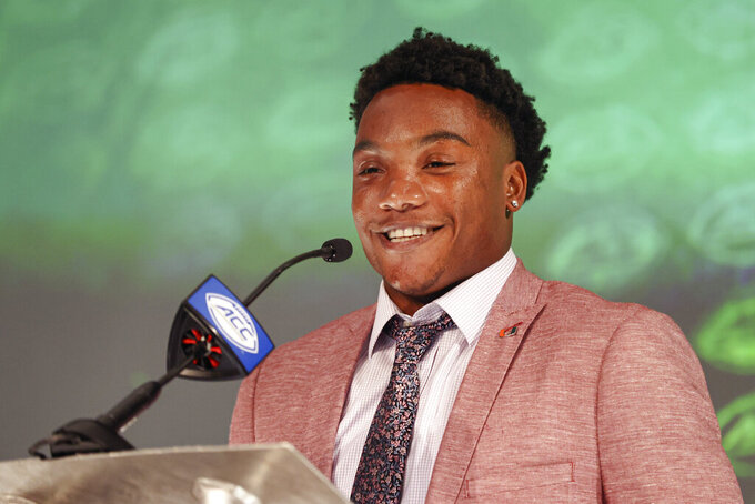 Miami quarterback D'Eriq King answers a question during the NCAA college football Atlantic Coast Conference media days in Charlotte, N.C., Wednesday, July 21, 2021. (AP Photo/Nell Redmond)