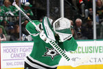 Dallas Stars goaltender Ben Bishop (30) uses his gloves to deflect a shot from the Winnipeg Jets in the second period of an NHL hockey game in Dallas, Thursday, Nov. 21, 2019. (AP Photo/Tony Gutierrez)