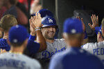 Los Angeles Dodgers' A.J. Pollock is congratulated after scoring on a double by Cody Bellinger against the Baltimore Orioles in the sixth inning of a baseball game Thursday, Sept. 12, 2019, in Baltimore. (AP Photo/Gail Burton)