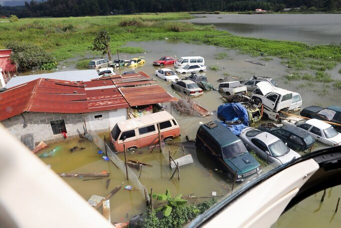 An aerial view of the massive, rain-fueled landslide in the village of Queja, in Guatemala, Saturday, Nov. 7, 2020, in the aftermath of Tropical Storm Eta. (Esteban Biba/Pool Photo via AP)