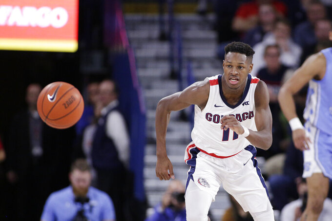 Gonzaga guard Joel Ayayi (11) goes after the ball during the second half of an NCAA college basketball game against North Carolina in Spokane, Wash., Wednesday, Dec. 18, 2019. Gonzaga won 94-81. (AP Photo/Young Kwak)