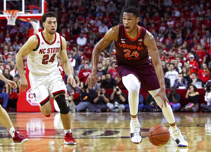 Virginia Tech's Kerry Blackshear Jr., right, dribbles ahead of North Carolina State's Devon Daniels, left, during the second half of an NCAA college basketball game in Raleigh, N.C., Saturday, Feb. 2, 2019. (AP Photo/Ben McKeown)