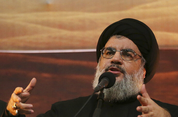 FILE - In this Nov. 3, 2014 file photo, Hezbollah leader Sheik Hassan Nasrallah addresses supporters ahead of the Shiite Ashura commemorations, in the southern suburb of Beirut, Lebanon. The leader of Hezbollah says U.S. sanctions against two lawmakers from his group are an offense to Lebanese state institutions which would need to defend themselves. Nasrallah, in a wide ranging interview late Friday, July 12, 2019, said such tactics won't sideline the group, because Hezbollah is a
