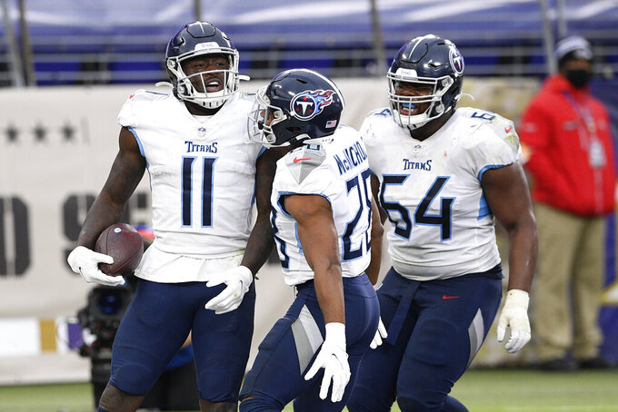 Tennessee Titans wide receiver A.J. Brown (11) celebrates his touchdown catch on a pass from quarterback Ryan Tannehill, not visible, during the second half of an NFL football game against the Baltimore Ravens, Sunday, Nov. 22, 2020, in Baltimore. (AP Photo/Nick Wass)