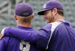 File-This May 28, 2014, file photo shows TCU baseball assistant coach Kirk Saarloos, right, talking with sophomore outfielder Boomer White (8) during practice, in Fort Worth, Texas. Former big league pitcher Saarloos was named TCU's new head baseball coach Tuesday, June 15, 2021, after nine seasons as the team's pitching coach that included four consecutive trips to the College World Series. Saarloos replaces Jim Schlossnagle, who left after 18 seasons last week to become Texas A&M's coach. (Brandon Wade /Star-Telegram via AP, File)