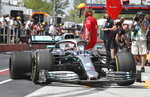 Mercedes driver Lewis Hamilton, of Britain, pulls into the pits with a broken rear tire after hitting the wall during the second practice session at the Formula One Canadian Grand Prix auto race, Friday, June 7, 2019, in Montreal. (Tom Boland/The Canadian Press via AP)