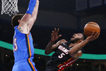 Miami Heat forward Derrick Jones Jr. (5) shoots as Oklahoma City Thunder forward Mike Muscala defends during the first half of an NBA basketball game Friday, Jan. 17, 2020, in Oklahoma City. (AP Photo/Sue Ogrocki)