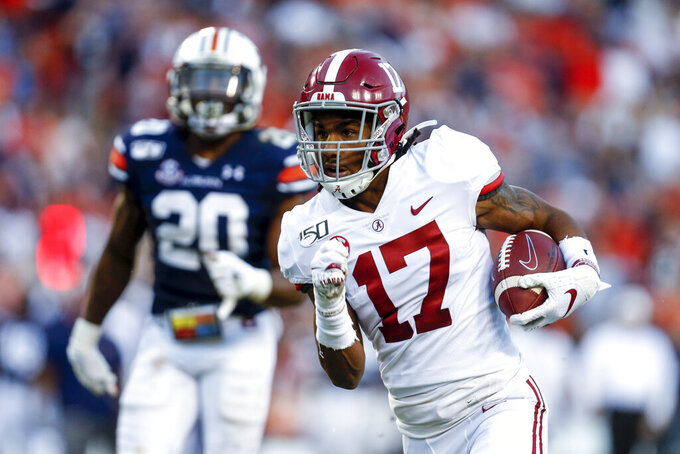 FILE - In this Saturday, Nov. 30, 2019 file photo, Alabama wide receiver Jaylen Waddle (17) carries the ball in for a touchdown after a reception in the first half of an NCAA college football game against Auburn in Auburn, Ala. The New York Giants spent the two months leading up to the draft in a somewhat unexpected dip into the free agency market that filled holes at wide receiver and cornerback, and narrowed their positional needs. (AP Photo/Butch Dill, File)