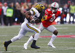 Michigan running back Karan Higdon, right, turns up field against Ohio State defensive back Kendall Sheffield during the first half of an NCAA college football game Saturday, Nov. 24, 2018, in Columbus, Ohio. (AP Photo/Jay LaPrete)