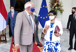 In this photo released by Indonesian Ministry of Foreign Affairs, Indonesian Foreign Minister Retno Marsudi, right, talks with European Union foreign affairs chief Josep Borrell during their meeting in Jakarta, Indonesia, Wednesday, June 2, 2021. Indonesia's foreign minister on Wednesday urged the Association of Southeast Asia Nations to immediately appoint a special envoy on Myanmar following a coup, and reiterated a call for the safety of civilians as the ruling junta cracks down on opposition. (Indonesian Ministry of Foreign Affairs via AP)