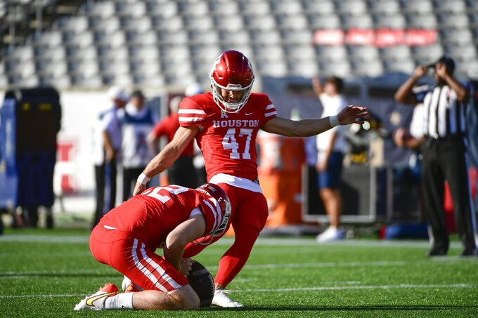 Houston place kicker Dalton Witherspoon (47) warms up with punter Laine Wilkins (22) before an NCAA college football game against Navy Saturday, Sept. 25, 2021, in Houston. (AP Photo/Justin Rex)