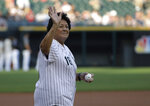 Former LPGA golfer Nancy Lopez waves before throwing a ceremonial first pitch before a baseball game between the St. Louis Cardinals and the Chicago White Sox in Chicago, Wednesday, July 11, 2018. (AP Photo/Nam Y. Huh)