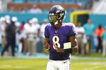 Baltimore Ravens quarterback Lamar Jackson (8), gestures, during the second half at an NFL football game against the Miami Dolphins, Sunday, Sept. 8, 2019, in Miami Gardens, Fla. (AP Photo/Wilfredo Lee)