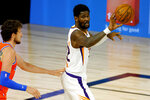 Phoenix Suns' Deandre Ayton looks to pass against the Oklahoma City Thunder during the second quarter of an NBA basketball game Monday, Aug. 10, 2020, in Lake Buena Vista, Fla. (Mike Ehrmann/Pool Photo via AP)