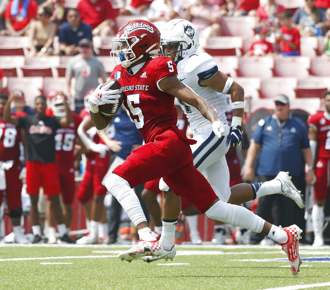 Fresno State's wide receiver Jalen Cropper runs for a touchdown run against Connecticut's defense during the first half of an NCAA college football game in Fresno, Calif., Saturday, Aug. 28, 2021. (AP Photo/Gary Kazanjian)