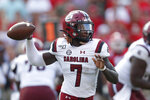 South Carolina quarterback Dakereon Joyner (7) throws on the run in the second half of an NCAA college football game against Georgia, Saturday, Oct. 12, 2019, in Athens, Ga. (AP Photo/John Bazemore)