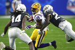 LSU wide receiver Derrick Dillon (19) eludes UCF defensive back Richie Grant (27) and defensive back Nevelle Clarke (14) during the first half of the Fiesta Bowl NCAA college football game Tuesday, Jan. 1, 2019, in Glendale, Ariz. (AP Photo/Ross D. Franklin)