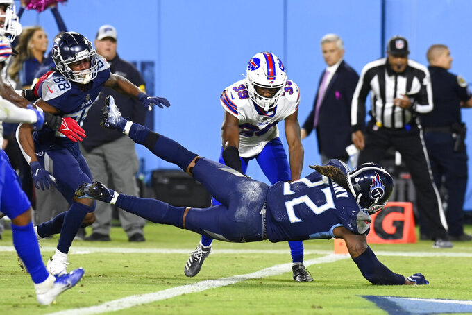 Tennessee Titans running back Derrick Henry (22) dives into the end zone for a touchdown ahead of Buffalo Bills cornerback Levi Wallace (39) in the second half of an NFL football game Monday, Oct. 18, 2021, in Nashville, Tenn. (AP Photo/Mark Zaleski)