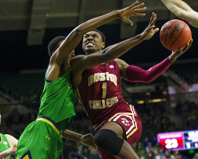 Boston College's Jairus Hamilton (1) drives against Notre Dame's Juwan Durham (11) during an NCAA college basketball game Saturday, Dec. 7, 2019 at Purcell Pavilion in South Bend, Ind. (Michael Caterina/South Bend Tribune via AP)