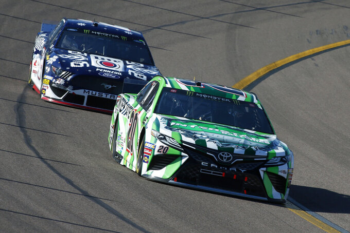 Erik Jones (20) and Brad Keselowski (2) during the NASCAR Cup Series auto race at ISM Raceway, Sunday, Nov. 10, 2019, in Avondale, Ariz. (AP Photo/Ralph Freso)