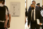 Former French President Nicolas Sarkozy, right, arrives at the court room in Paris, Tuesday, June 15, 2021. Nicolas Sarkozy goes trial on charges that his unsuccessful reelection bid was illegally financed. (AP Photo/Rafael Yaghobzadeh)