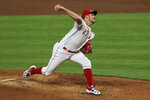 Cincinnati Reds' Trevor Bauer throws in the third inning during a baseball game against the Chicago White Sox in Cincinnati, Saturday, Sept. 19, 2020. (AP Photo/Aaron Doster)