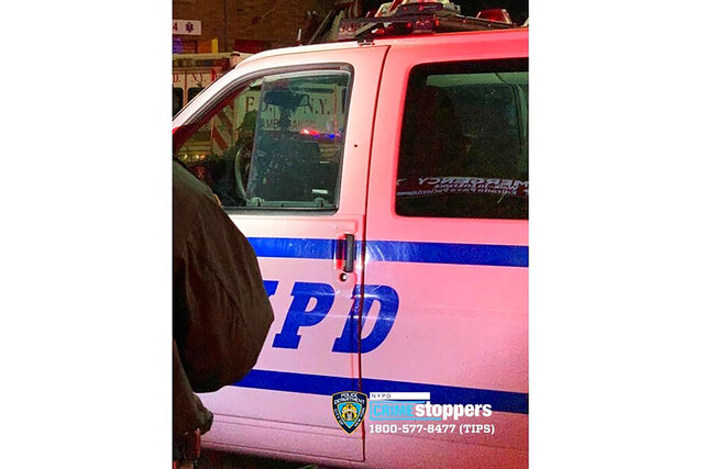 This photo provided by the New York Police Department shows a police van with a bullet hole above the door handle after a shooting in the Bronx borough of New York on Saturday, Feb. 8, 2020. A New York City police officer was wounded by gunfire in the Bronx on Saturday night in what Commissioner Dermot Shea called