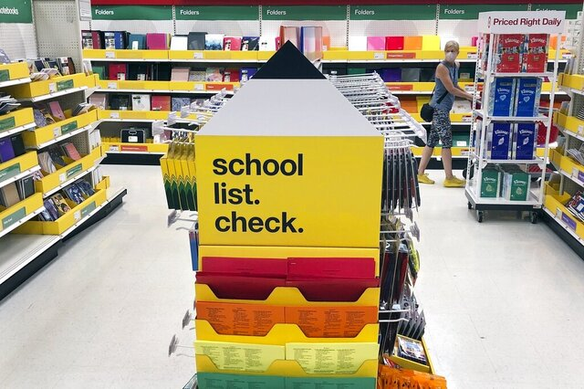 FILE - Back-to-school supplies await shoppers at a store on Saturday, July 11, 2020, in Marlborough, Mass.  The pandemic has dragged into the new school year and wreaked havoc on reopening plans. That has extended to the back-to-school shopping season, the second most important period for retailers behind the holidays.  (AP Photo/Bill Sikes, File)