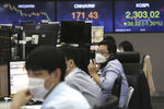 A currency trader talks on the phone at the foreign exchange dealing room of the KEB Hana Bank headquarters in Seoul, South Korea, Thursday, Sept. 24, 2020. Asian shares were mostly lower Thursday as caution again after a retreat on Wall Street driven by a decline in technology shares. (AP Photo/Ahn Young-joon)