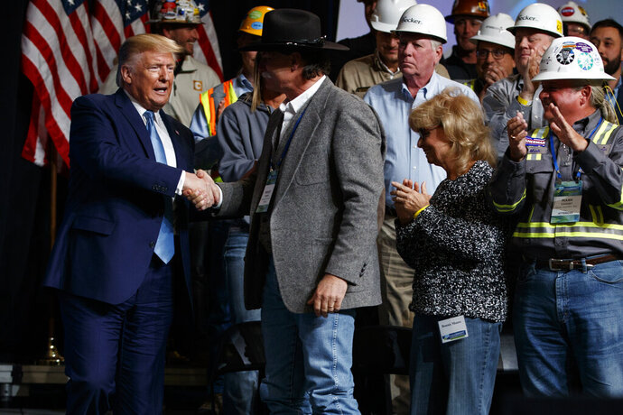President Donald Trump arrives to speak to the 9th annual Shale Insight Conference at the David L. Lawrence Convention Center, Wednesday, Oct. 23, 2019, in Pittsburgh. (AP Photo/Evan Vucci)