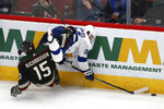 Arizona Coyotes center Brad Richardson (15) trips Tampa Bay Lightning center Steven Stamkos, right, during the third period of an NHL hockey game Saturday, Feb. 22, 2020, in Glendale, Ariz. The Coyotes won 7-3. (AP Photo/Ross D. Franklin)