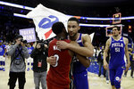 Miami Heat's Dwyane Wade, left, and Philadelphia 76ers' Ben Simmons meet after an NBA basketball game Thursday, Feb. 21, 2019, in Philadelphia. Philadelphia won 106-102. (AP Photo/Matt Slocum)