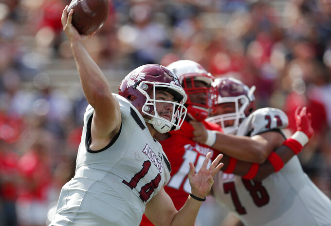 New Mexico State quarterback Josh Adkins (14) throws during the first half of an NCAA college football game against New Mexico on Saturday, Sept. 21, 2019 in Albuquerque, N.M. (AP Photo/Andres Leighton)