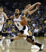 San Antonio Spurs' Patty Mills (8) drives the ball past Golden State Warriors' Klay Thompson during the first half of an NBA basketball game Wednesday, Feb. 6, 2019, in Oakland, Calif. (AP Photo/Ben Margot)