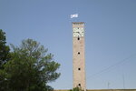 FILE - In this Saturday, Aug. 14, 2021 file photo, a Taliban flag flies from the clocktower of the Herat provincial official office, in Herat, Afghanistan, west of Kabul. (AP Photo/Hamed Sarfarazi)