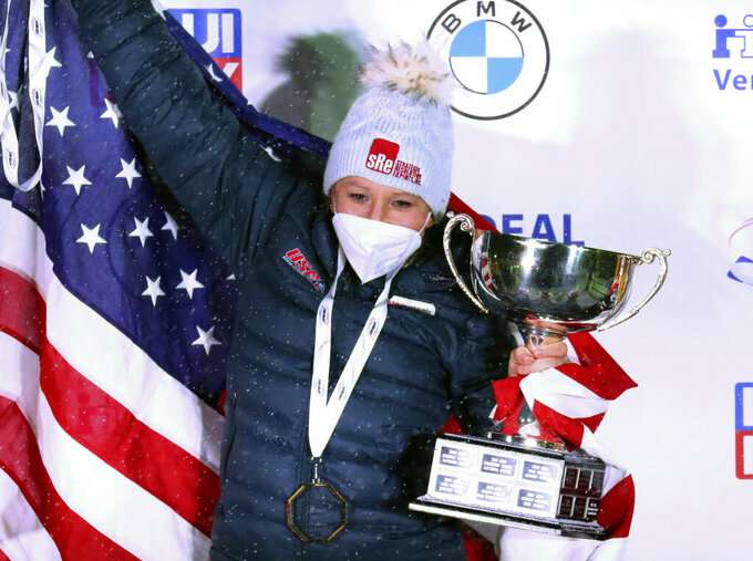 FILE - In this Feb. 6, 2021, file photo, Kaillie Humphries celebrates after winning with Lolo Jones the two-women's bobsled race at the Bobsled and Skeleton World Championships in Altenberg, Germany.  Reigning women's world bobsled champion and three-time Olympic medalist Humphries of the U.S. has asked the International Olympic Committee for a solution that would allow her to compete in this winter's Beijing Games even though her American citizenship will not be finalized. (AP Photo/Matthias Schrader, File)