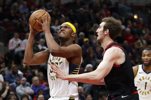 Indiana Pacers' Myles Turner, left, drives to the basket against Chicago Bulls' Luke Kornet during the first half of an NBA basketball game in Chicago, Friday, Jan. 10, 2020. (AP Photo/Nam Y. Huh)