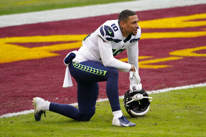 Seattle Seahawks wide receiver Freddie Swain (18) on the field before the start of an NFL football game against the Washington Football Team, Sunday, Dec. 20, 2020, in Landover, Md. (AP Photo/Andrew Harnik)