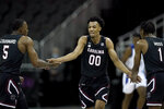 South Carolina's AJ Lawson (00) celebrates with Jermaine Couisnard (5) and T.J. Moss (1) after making a basket during the second half of an NCAA college basketball game against Tulsa Sunday, Nov. 29, 2020, at the T-Mobile Center in Kansas City, Mo. (AP Photo/Charlie Riedel)