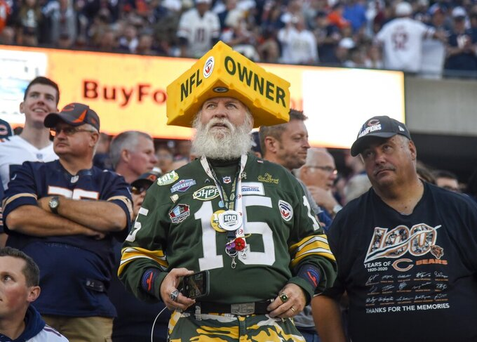 A Green Bay Packers fan watches before the start of an NFL football game against the Green Bay Packers Thursday, Sept. 5, 2019, in Chicago. (AP Photo/David Banks)