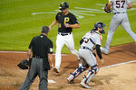 Pittsburgh Pirates' Bryan Reynolds (10) scores past Detroit Tigers catcher Eric Haase on a two-run single by Ben Gamel off Tigers relief pitcher Alex Lange (57) during the sixth inning of a baseball game in Pittsburgh, Tuesday, Sept. 7, 2021. (AP Photo/Gene J. Puskar)