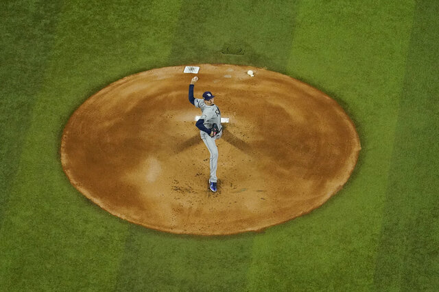 Tampa Bay Rays starting pitcher Blake Snell throws against the Los Angeles Dodgers during the first inning in Game 2 of the baseball World Series Wednesday, Oct. 21, 2020, in Arlington, Texas. (AP Photo/David J. Phillip)