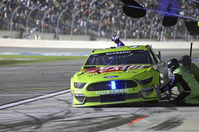 Anthony Alfredo (38) makes a pit stop during a NASCAR Cup Series auto race at Daytona International Speedway, Saturday, Aug. 28, 2021, in Daytona Beach, Fla. (AP Photo/Phelan M. Ebenhack)