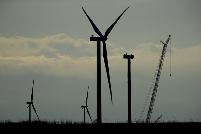 Wind turbines stand in various stages of completion at the Reading Wind Facility in Reading, Kan., on Thursday, April 23, 2020. Although the wind power project has experienced some delays in delivery of some foreign-sourced parts and had to implement social distancing measures, the project is on schedule to be completed in the next few weeks. (AP Photo/Charlie Riedel)